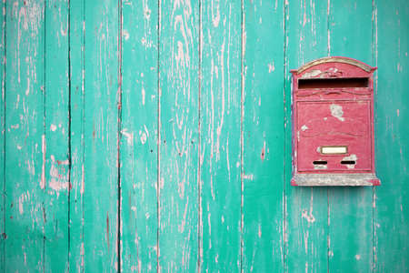 Letter Box On Green Wood Door Stock Photo
