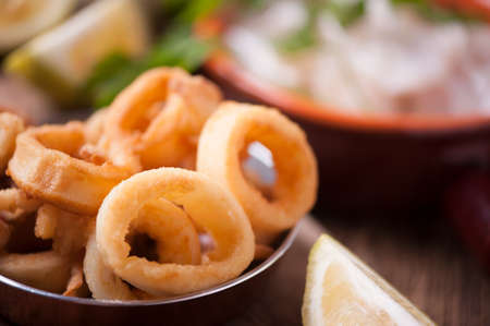 Fried calamari squid on wooden table