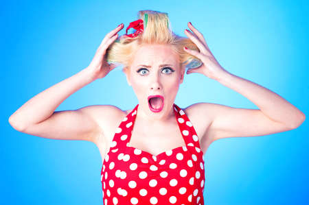 hair roller: Crazy housewife with curlers isolated on blue