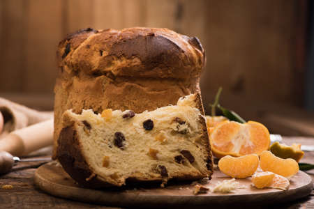 Slice of a panettone close up. Panettone Stock Photo - 89434328