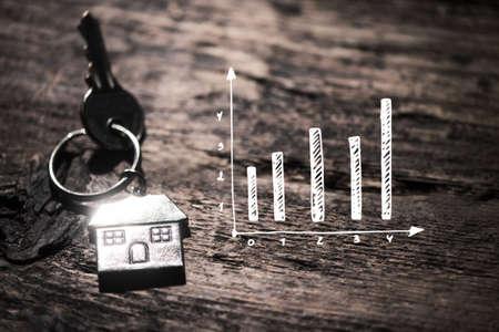 House key on a wooden table Foto de archivo
