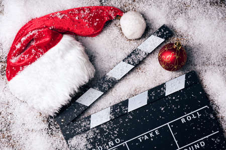 Christmas hat with film board in the snow