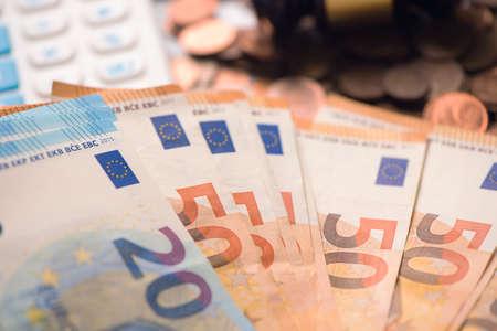 Euro money and calculator Stock Photo