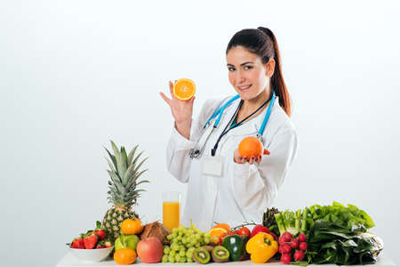 Female dietitian in uniform with stethoscope