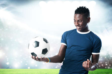 Footbal supporter with blue shirt and ball