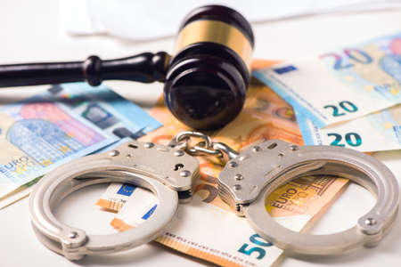 Gavel, handcuff with euro money. Crime and fraud concept