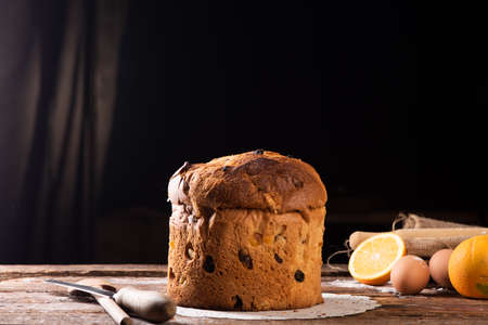 Italian Christmas cake on wooden table. Homemade Panettone Stock Photo - 109618182
