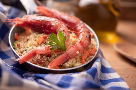 Fish couscous with prawns Stock Photo