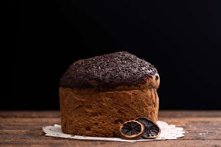 Choccolate panettone on a rustic table