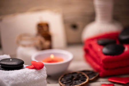 Wellness docoration on valentines day with candels and stones close up Stock Photo