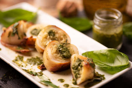Grilled squid stuffed with basil closeup.