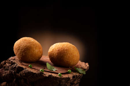 Arancini - italian rice balls which are coated with bread crumbs and then deep fried Banco de Imagens