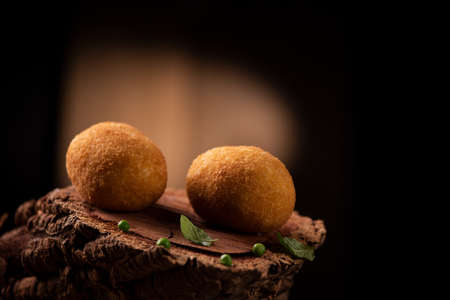Arancini - italian rice balls which are coated with bread crumbs and then deep fried Imagens