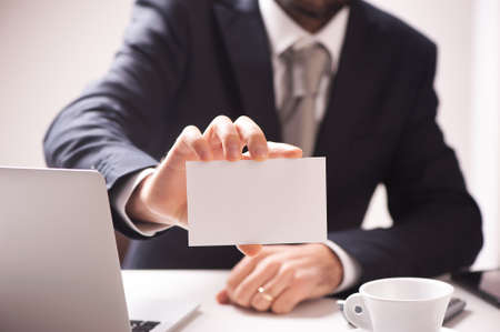 Businessman showing his visiting card - free space in the textarea Stock Photo