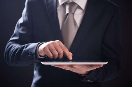 Business Man Using Touch Screen Tablet close up