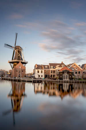 Windmill and traditional houses, Haarlem, Holland  at sunset