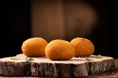 Arancini di riso, fried risotto rice balls, italian sicilian food close up