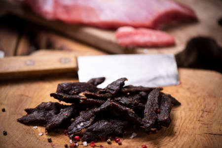 Beef Jerky on  wooden background close up Stock Photo