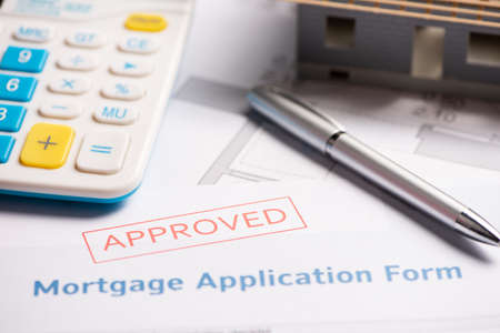 Approved mortgage loan agreement application. Close up