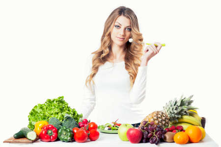 Young blonde attractive woman eating salad close up 写真素材