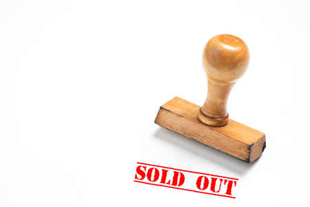 Rubber stamp with sold out sign on white Stockfoto