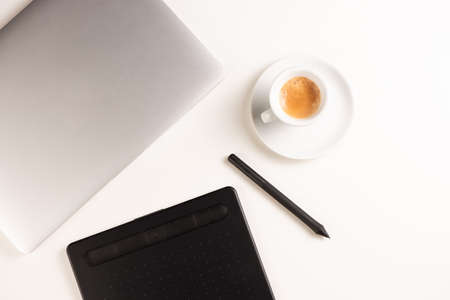 Graphic Designer white work table with computer and coffee. Desk top view.