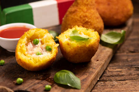 Delicious rice balls made with fried rice. typical dish of sicilian italian cuisine . Arancini close up Banco de Imagens