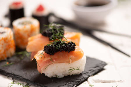 Shushi and black caviar close up 스톡 콘텐츠