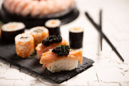 Shushi and black caviar close up Foto de archivo