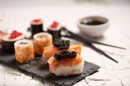 Shushi and black caviar close up