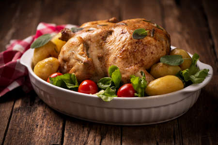 Roasted turkey garnished with potato and veg.