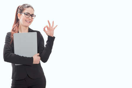 A business woman showing OK hand sign smiling happy 版權商用圖片