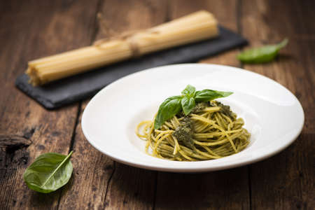 Spaghetti Pesto alla Genovese on rustic wooden table