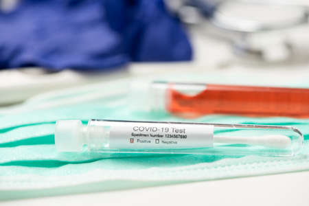 Blood test for COVID-19. Examination of a blood sample for the presence of SARS-CoV-2 coronavirus close up 版權商用圖片