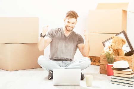 moving alone to new apartment. Portrait lifestyle Banco de Imagens