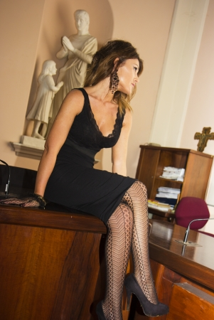sexy secretary: Model posing indoor as a sexy secretary Stock Photo