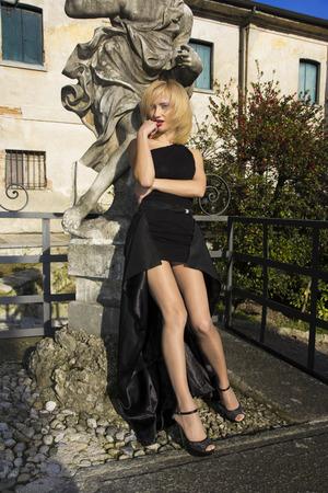 Fantastic model posing in italian villa Stock Photo