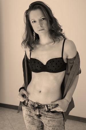 Slim and fit model posing in bra Stock Photo