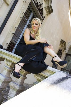 Beautful model posing in a classy black outfit
