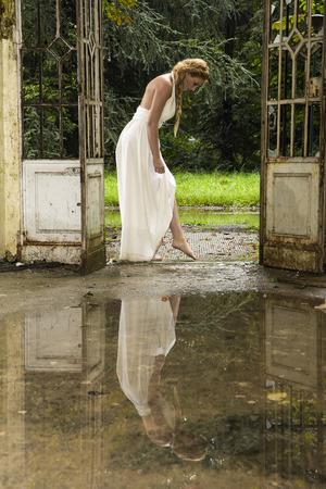 Fantastic blonde model posing as a Greek Goddess