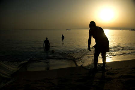 fishermen group during sunrise Stock Photo - 4080880