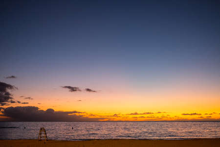 """Tenerife Spain -€"""" december 16 2014 - baywatch seat in the sunset photo"""
