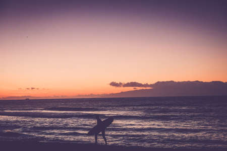 the americas: Las Americas Spain, December 09 2014: beach surfer go home in the sunset