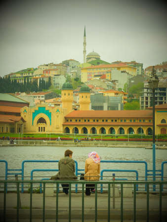 couple in Istanbul in front of a mosquee photo