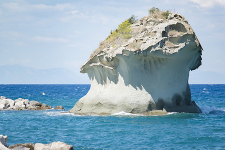 Ischia mushroom rock on the shore of Lacco Ameno Stock Photo