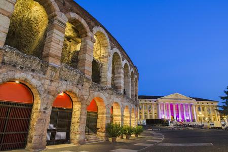 Arena of Verona with illuminated City Hall