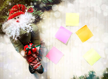 postit note: Christmas decorations on wooden planks Stock Photo