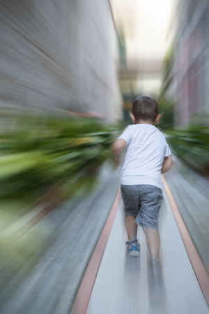 accelerated: child playing in the park
