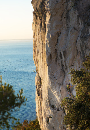 free climbing: free climbing on a cliff face on the coast of Trieste