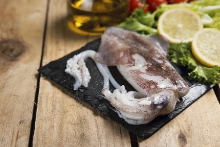 feeler: Fresh squid served on a slate plate